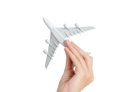copys pace: Woman hand holding model aeroplane, isolated on white background. Stock Photo