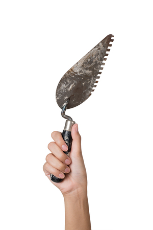 worker woman hand holding trowel, isolated on white background. Stock Photo