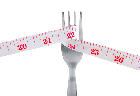 Measuring tape on fork in lose weight concept, Isolated on white background. Stock Photo