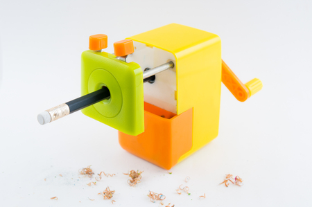 resourceful: colorful rotary pencil sharpener with pencil, on white background Stock Photo