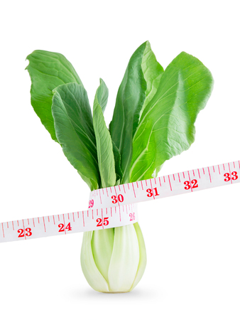 bok choy: Measuring tape on Vegetable in lose weight concept, Isolated on white background. Stock Photo