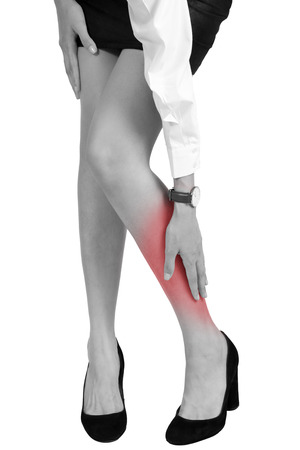 Woman holding her calf in pain area, with red highlighted, black and white color  isolate on white background.