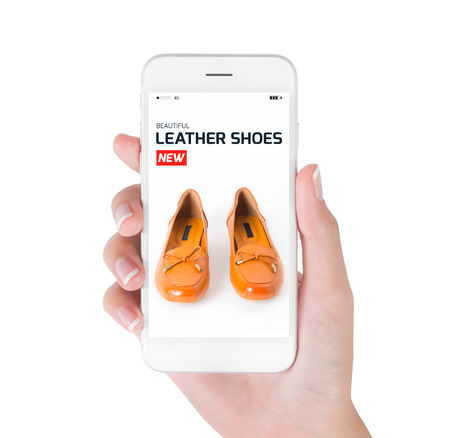 woman using smart phone searching new trendy leather shoes fashion information, View of profile with red tag and brown leather shoes. Fashion and accessories concept, isolated white background.