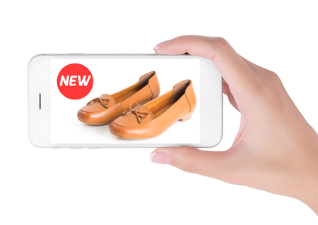 loafer: woman using smart phone searching new trendy leather shoes fashion information, View of profile with red tag and brown leather shoes. Fashion and accessories concept, isolated white background.