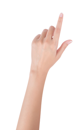 Woman hand pointing up with index finger or touching screen, back hand side, isolated on white background. Stock Photo
