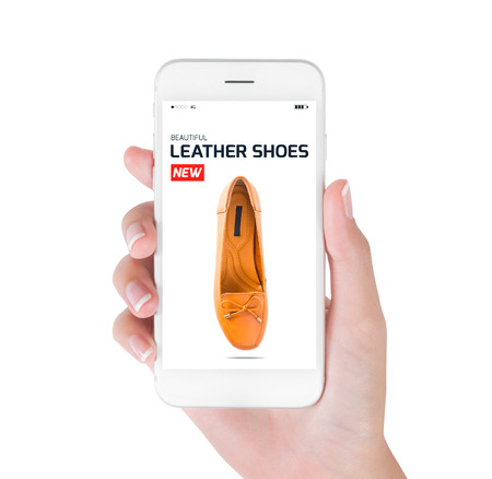 boxing day: woman using smart phone searching new trendy leather shoes fashion information, View of profile with red tag and brown leather shoes. Fashion and accessories concept, isolated white background.