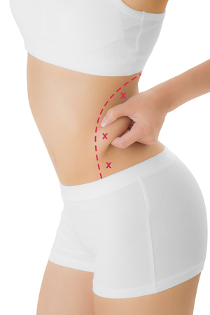 Woman grabbing skin on her hip with the red color crosses marking, Lose weight and liposuction cellulite removal concept, Isolated on white background.