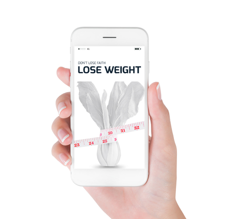 Woman using her smart phone searching lose weight information, Measuring tape wrapped on white vegetables in lose weight and diet concept, Isolated on white background.
