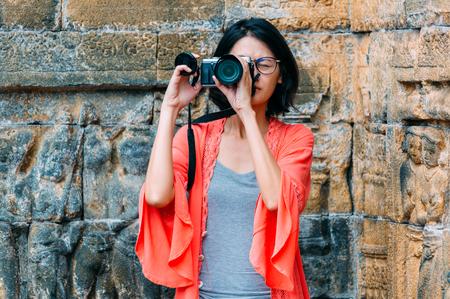 Asian female solo travelers and take photo ancient buildings- Borobudur temple- Java -Indonesia- Asia. Reklamní fotografie