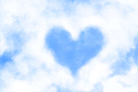 Image illustration of blue sky peeping from heart-shaped cloud 写真素材