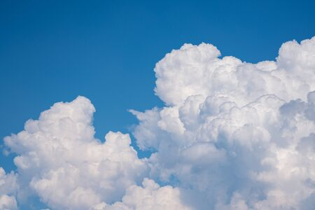 Beautiful view of the cloudy sky. White cumulus beautiful clouds float in the blue sky.