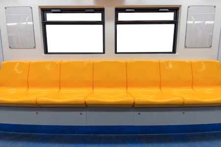 Yellow chair and windows in electric train