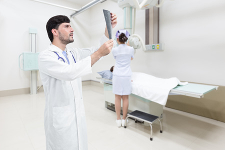 Doctor examining x-ray image in hospital room