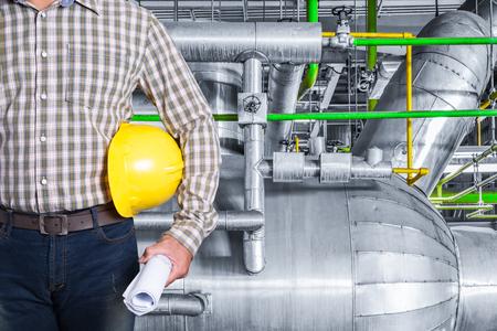 Maintenance technician inside thermal power plant factory