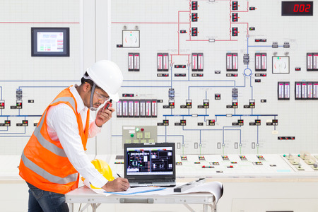 chernobyl: Electrical engineer working at control room of a modern thermal power plant