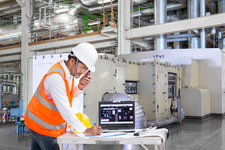 Engineer using laptop computer for maintenance equipment in thermal power plant factory