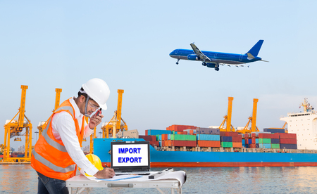 Engineer dockers talking on the walkie-talkie for controlling loading container and recording data in an industrial harbor for logistic Import export background