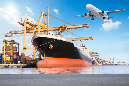 Container cargo freight ship with working crane loading bridge in port and cargo freight plane in transport for logistic Import export concept Standard-Bild