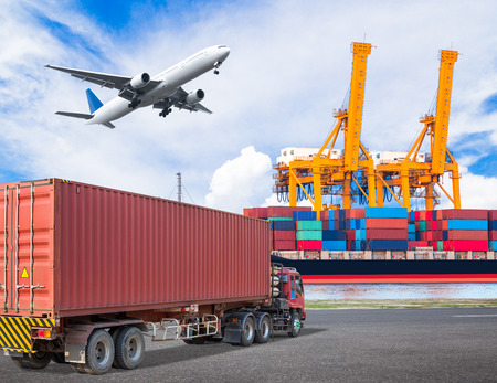 Truck transport container and cago plane flying above ship port with working crane loading bridge in shipyard for logistic import export concept