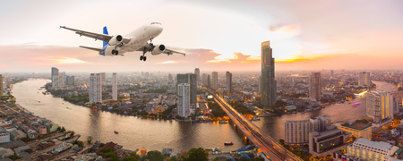 Airplane take off over the panorama city at sunset Standard-Bild
