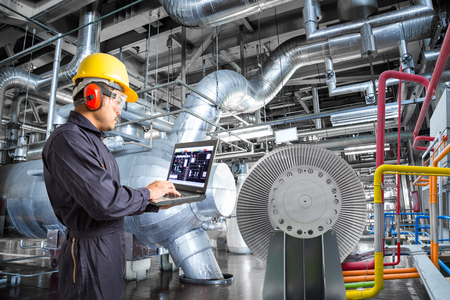 Engineer using laptop computer for maintenance in thermal power plant industrail