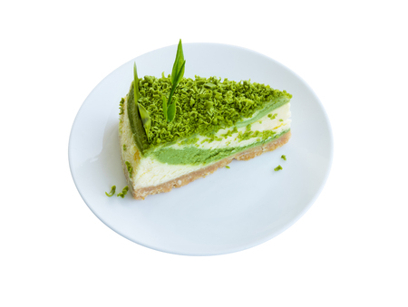 Green tea cheesecake dessert on plate isolated on white background Stok Fotoğraf - 120583919