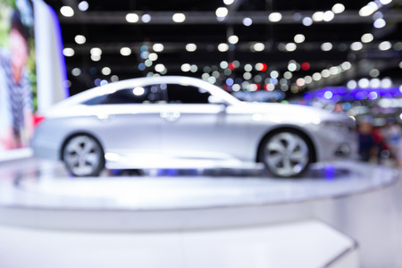 Blurred image of car exhibition show, innovative automotive exhibitions concept