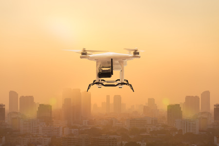 Drone flying to measure dust particles in the air over metropolis, Technology 4.0 concept Reklamní fotografie