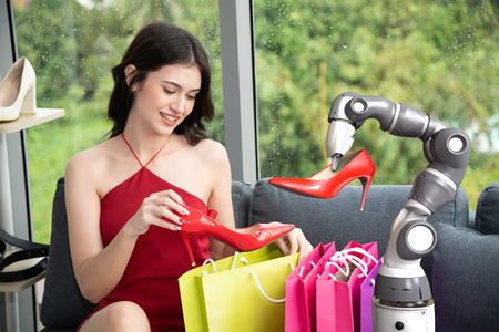 Robot assistant with happy shopping woman select high heels shoes, Smart robotic technology concept Reklamní fotografie