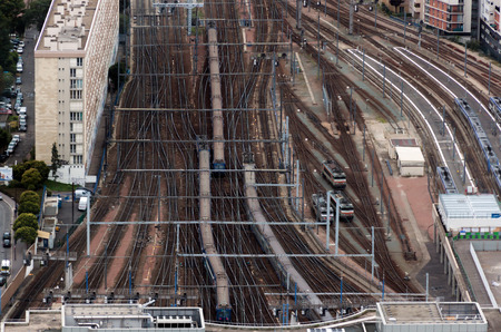 railway points: Railroad tracks and trains near the big station as seen from high altitude Stock Photo