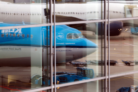 turbofan: Reflection of the aircrafts in airport windows. Amsterdam airport