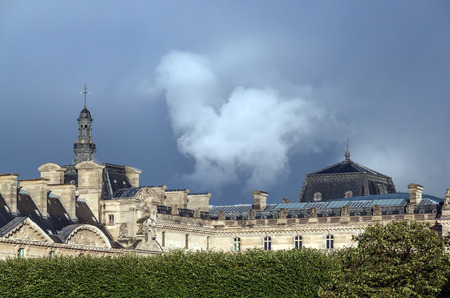 carrousel: Thunderclouds over the Louvre Palace Richelieu Wing seen from the Arc de Triomphe du Carrousel triumphal arch in Paris, France