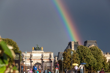 capita: Rainbow over Arc de Triomphe du Carrousel and the Louvre Palace , Paris, France