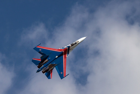 belongs: Sukhoi Su-27, NATO reporting name: Flanker fighter in flight. It belongs to the aerobatic team Russian knights.