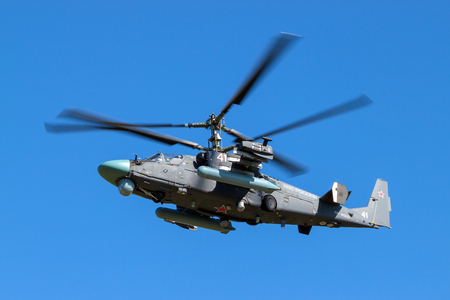 distinctive: Russian attack helicopter with the distinctive coaxial rotor system (Ka-52 Alligator) in flight