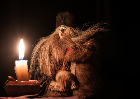 sorcery: Witch looking at burning candle