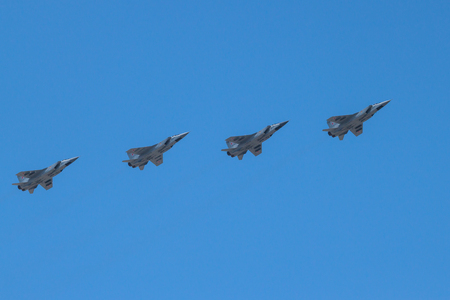 supersonic: Four supersonic interceptor aircrafts MiG-31 in flight. Vicrory Day parade, Moscow, Russia, May, 9 2016. Blue sky in the background