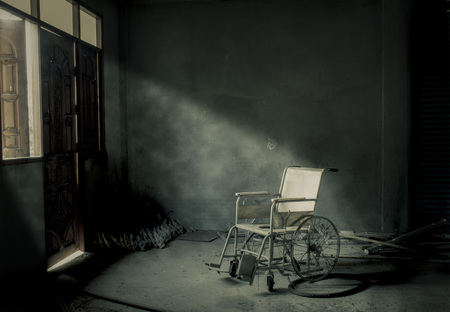 An old wheelchair in old room