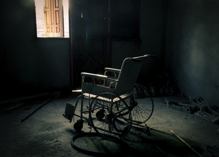 negligent: An old wheelchair in old room