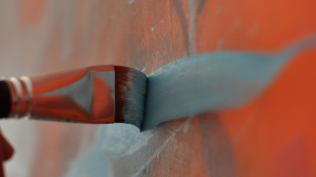 An artist is showing some techniques of painting Stock Photo