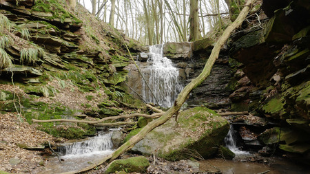 A river flow  waterfall in the gorge Margarethe. Located in Germany, in the Neckar Odenwald district.