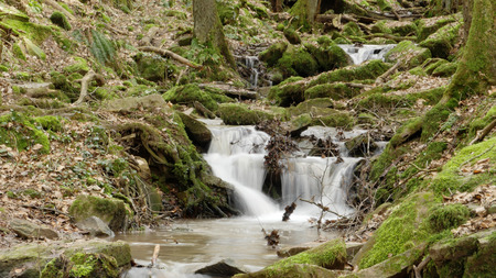 A river flow  waterfall in the gorge Margarethe shot with a long shutter speed. Located in Germany, in the Neckar Odenwald district.