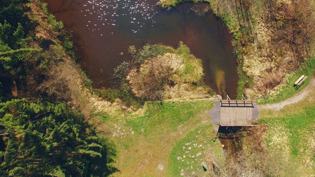 Top view of a wooden bridge at the Eutersee. The Eutersee is a little lake in South Hessia, Germany.