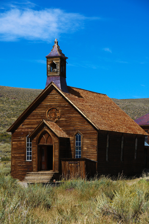 Beautiful view of the church. Old church in a ghost town on a sunny day.