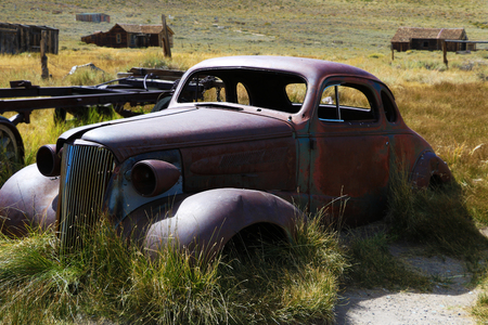 Old car: old car, rusty, in a field, in a historic ghost town, Bodie Banco de Imagens