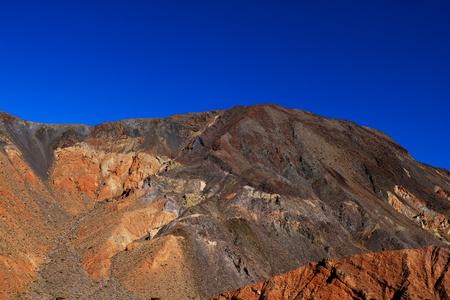 Moon Over Zabriskie Point Mudstones form Badlands Death Valley National Park California Banco de Imagens