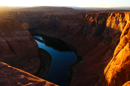 Beautiful view of the Horseshoe Bend, Arizona, under warm sunset light