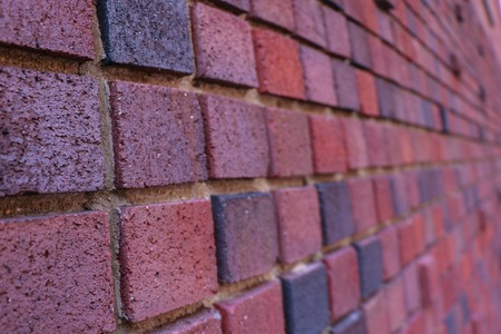 brick wall of red color, wide panorama of masonry Standard-Bild