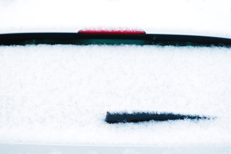 car windshield wiper in the snow Stock Photo