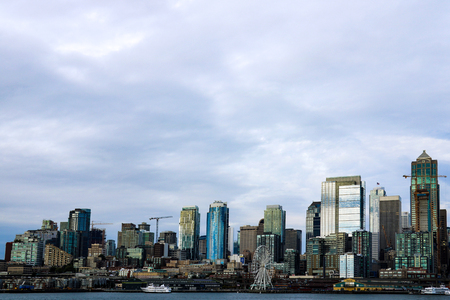 Buildings and waterfront attractions Elliott Bay Seattle downtown skyline